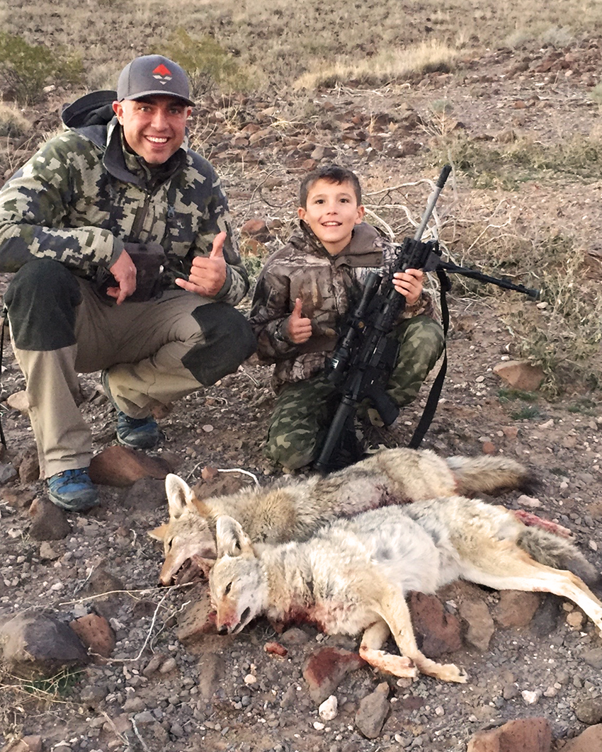 Predator Exclusives, guide, Craig Steele with Miles & his first coyote.